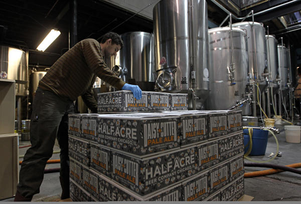 Sam McClain stacks Daisy Cutter Pale Ales at Half Acre Beer Company in Chicago in January.