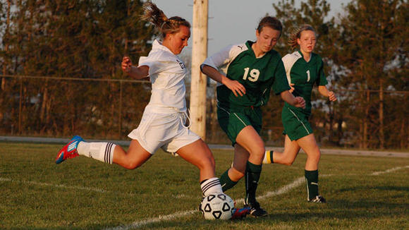 Gaylord forward Sarah Polena attempts a shot while shadowed closely by West's Nicole Sanford during Tuesday's tie game.