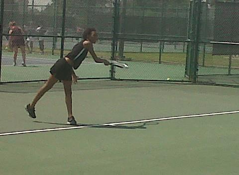 Woodside's Kenya Northern serves at the 2012 Peninsula District tennis tournament at Huntington Park.