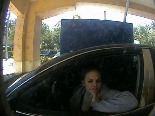Delray Beach Police are looking for a woman suspected of check fraud for cashing a check from a purse that was stolen from a car in Martin County.