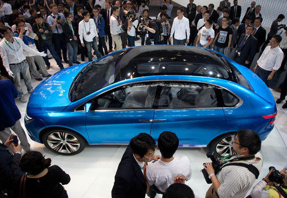 The Denza electric car, created jointly by Daimler and Chinese manufacturer BYD, is unveiled April 23 at the Auto China 2012 car show in Beijing. The EVS26 symposium opening Sunday in L.A. will see a few new electric cars but is about the entire electric vehicle infrastructure.
