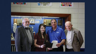 Robert Koot, successor trustee of the John and Ann Koot Memorial Fund, Stephanie Wilusz, the winner of this year's essay award presented by the fund, Ralph Demarco, principal of the Windber Area High School and John Fluder, trustee of the John and Ann Koot Memorial Fund, pose for a photo after presenting Wilusz with her certificate for winning this year's contest.