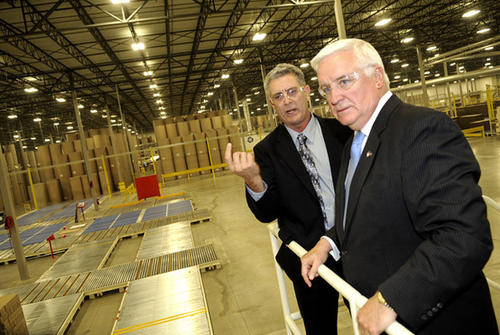 Gov. Tom Corbett, right, tours the new Pratt Industries corrugated box plant with Wayne Villis, left.