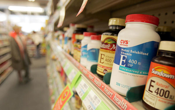 Bottles of Vitamin E are seen in a CVS pharmacy.