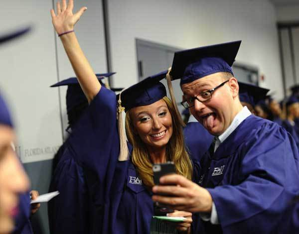 International Business and Trade majors Daniella Eaton and Lukasz Inanks pose for a self portrait before their graduation from Florida Atlantic University Thursday afternoon.  They were part of the largest graduating class in FAU history. The University will graduate 2901 students over two days and five ceremonies.