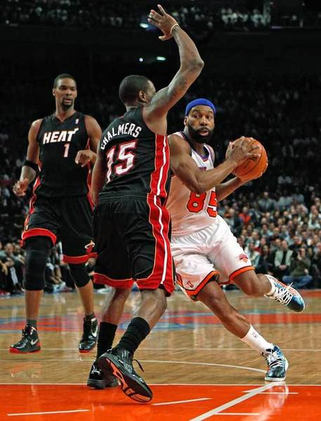 Baron Davis #85 of the New York Knicks drives in the first quarter against Mario Chalmers #15 of the Miami Heat in Game Three of the Eastern Conference Quarterfinals in the 2012 NBA Playoffs on May 3, 2012 at Madison Square Garden in New York City.