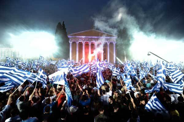 Supporters of Leader of the Greek conservative party New Democracy Antonis Samaras wave flags during a pre-election speech in Athens on May 3, 2012. Crunch elections in Greece on May 6 may not produce a government with a strong enough mandate to push through yet more austerity cuts to satisfy Athens' international creditors. Sunday's election is expected to see Greek voters, many of them fed up with grinding austerity drives, vote for parties that say they would scrap deals with the EU and IMF.
