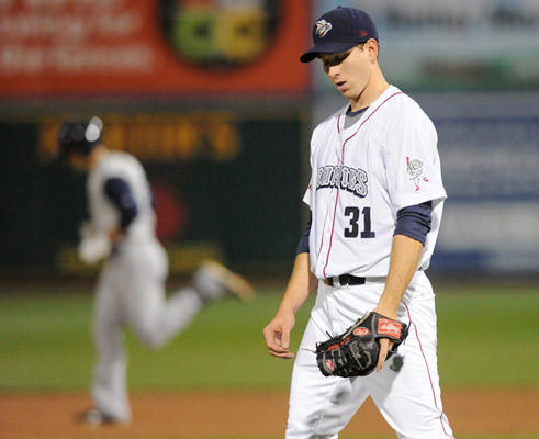 Lehigh Valley IronPigs' Pitcher Austin Hyatt (31) left , walks around the mound after giving up a home run to the Charlotte Knights' Connor Jackson (36) at Coca-Cola Park Thursday night.