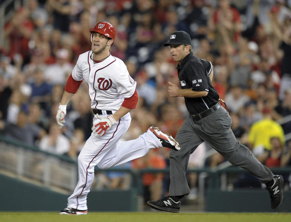 Washington's Bryce Harper heads to second base on an RBI double against the Arizona Diamondbacks in the sixth inning on Thursday during the Nationals' 2-1 victory.