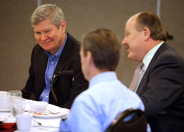 U.S. Sen. Tim Johnson, D-S.D., left, shares a light moment with Northern State University president James Smith, right, and Aberdeen Mayor Mike Levsen, back to camera center, during Thursday's Aberdeen Chamber of Commerce Government Affairs lunch meeting at the Ramada Inn.