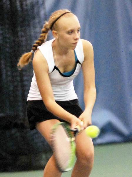 Harbor Springs' Emily Lesky volleys during her No. 3 singles match against Alpena's Abbey Jackson Thursday at Bay Tennis and Fitness in Harbor Springs. Lesky defeated Jackson, 6-0, 6-0, as the Rams went on to win the non-league match, 8-0.