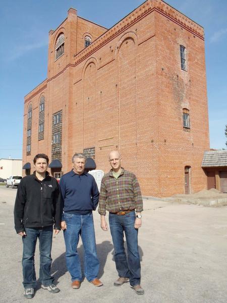 Petoskey Brewing general manager Steve Steffes (from left) and partners Lou Gostinger and Patrick Dowd stand outside the building along M-119 near Petoskey that they plan to return to use as a brewery.
