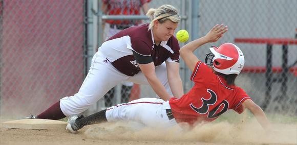 Bourbon County third baseman Hannah Wagner attempts to tag out George Rogers Clark base runner Bryah Campbell during the Lady Colonels¿ 12-2 victory in five innings Thursday at Cardinal Heights. Campbell was safe on the play and eventually scored.