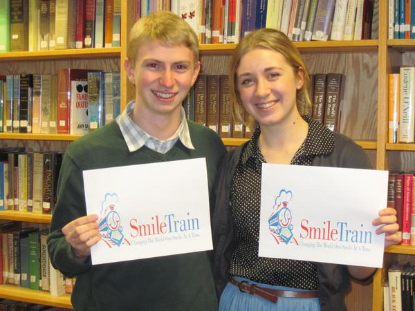 Petoskey High School student council members Carter Cohen (left) and Kelly Ronquist are planning a concert to benefit the Smile Train, a charity that raises money to provide surgeries to people with cleft lips or palates.