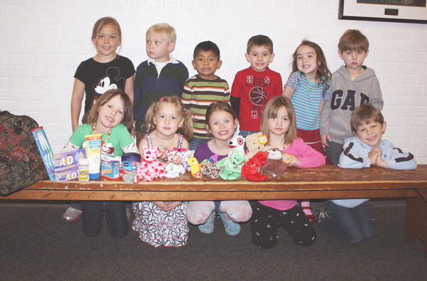 St. Mary School students participating in a mission drive include (front, from left) Abbigail Cesaro, Lauren Dishinger, Kinsey Vachon, Breanaka Spang, Michael Mervyn; (back) Mary Lentz, Flynn Sober, Hayden Brya, Benjamin Dallo, Sloane Hayes and Nicholas Rogacheski.