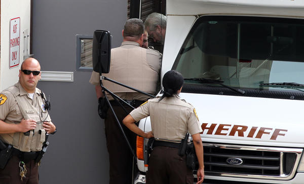 Drew Peterson makes his way into the Will County Courthouse in Joliet, Ill., today.