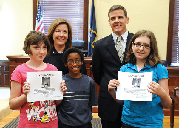 Fannie Bush students who were finalists in the Law Day 2012 quiz challenge are, from left, Ashton Roberts, Devantay Parker and Madison Ballard, bottom photo. With them is Judge Logue and local attorney David Ward, who visited the fifth grade students at their school earlier in the week.