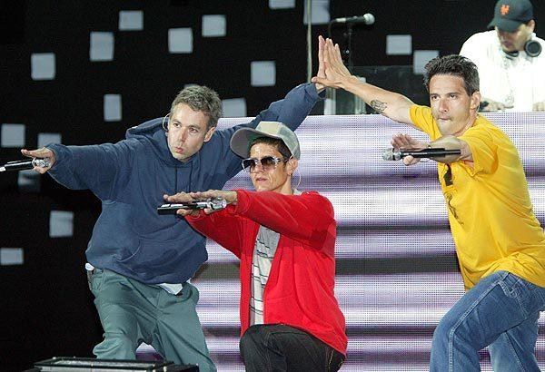 "Beastie Boys Adam ""MCA"" Yauch, left, Mike ""Mike D"" Diamond and Adam ""Ad-Rock"" Horowitz perform at the Kroq Weenie Roast 2004 concert at the Verizon Wireless Amphitheater in Irvine."