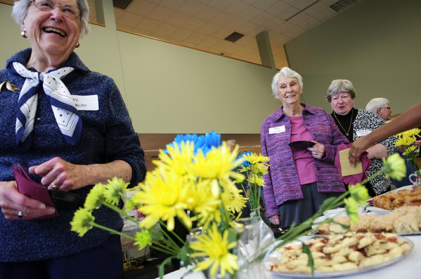"May Checko, Mary Long and Barbara Davis attend a breakfast buffet prepared by Windsor High School culinary arts students and WHS food service staff  for an ""Older Americans Month Breakfast"" in the Windsor High School library. The event was hosted by Winsor's Interim Superintendent of School Dr. Jeffrey A. Villar and talks were offered by town officials and Windsor High School students."