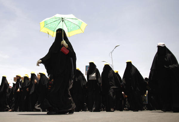 Women march during a demonstration demanding a trial for Yemen's former President Ali Abdullah Saleh, in Sanaa May 3, 2012.