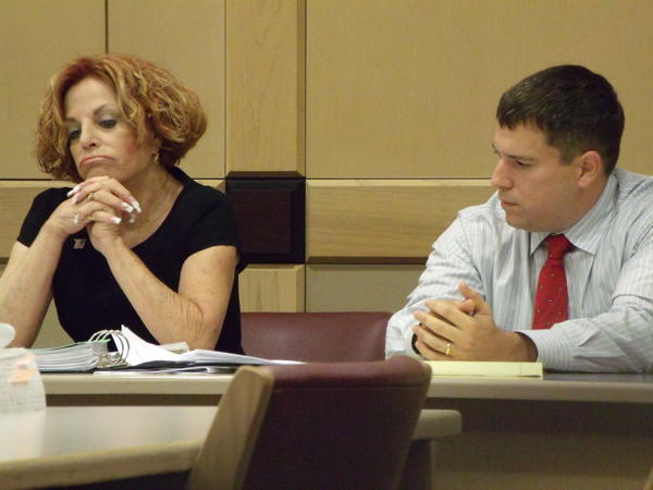 Deputy David Wimberley, right, and defense lawyer Rhea Grossman listen as a prosecutor makes closing arguments in Wimberleys misdemeanor falsifying records trial.