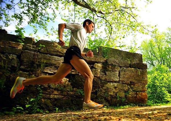 Dr. Mark Cucuzzella shows good running form Thursday on the C&O Canal at Shepherdstown, W.Va. Cucuzzella finished the 2012 Boston Marathon fourth in his age group.