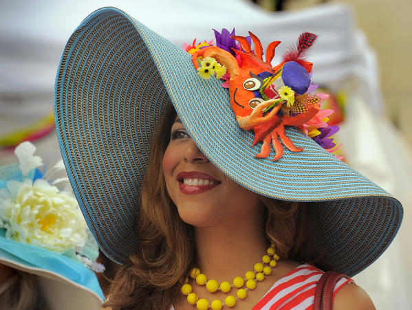 Nikki Bass of Perry Hall waits to participate in the Grand Hat Contest at Baltimore's Flowermart 2012