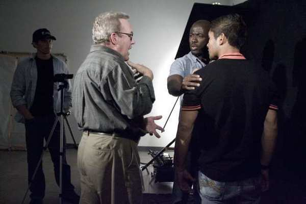Mentor Fred Bailey, from second left, directs his students, Joe Fidler, from far left, Alex Sonpon and Steve Angeles at International Academy of Film and Television in Burbank on Thursday. The school opened on April 20, 2012 and have schools in Miami and Cebu, Philippines. They will also be opening a school in Hong Kong.