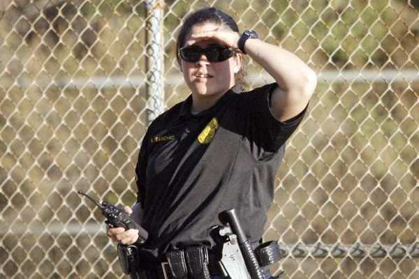 Officer Kristiana Sanchez practices a pursuit during a police training at the Starlight Bowl in Burbank. Less than 10% of the department's officers are women.