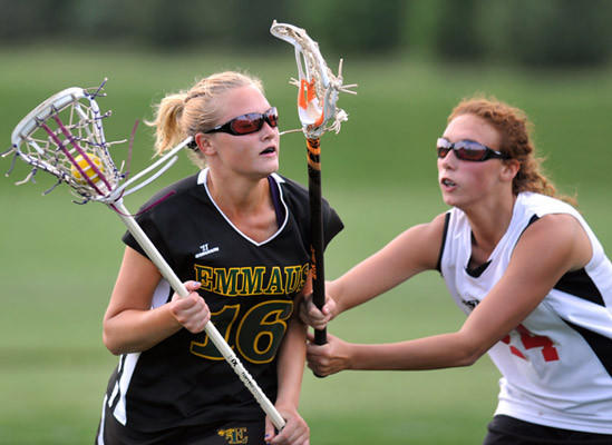 Emmaus's #16 Sarah Kazmierski is defended by Easton's #24 Breanna Schurgot in their girls lacrosse game held at Easton Middle School on Friday.
