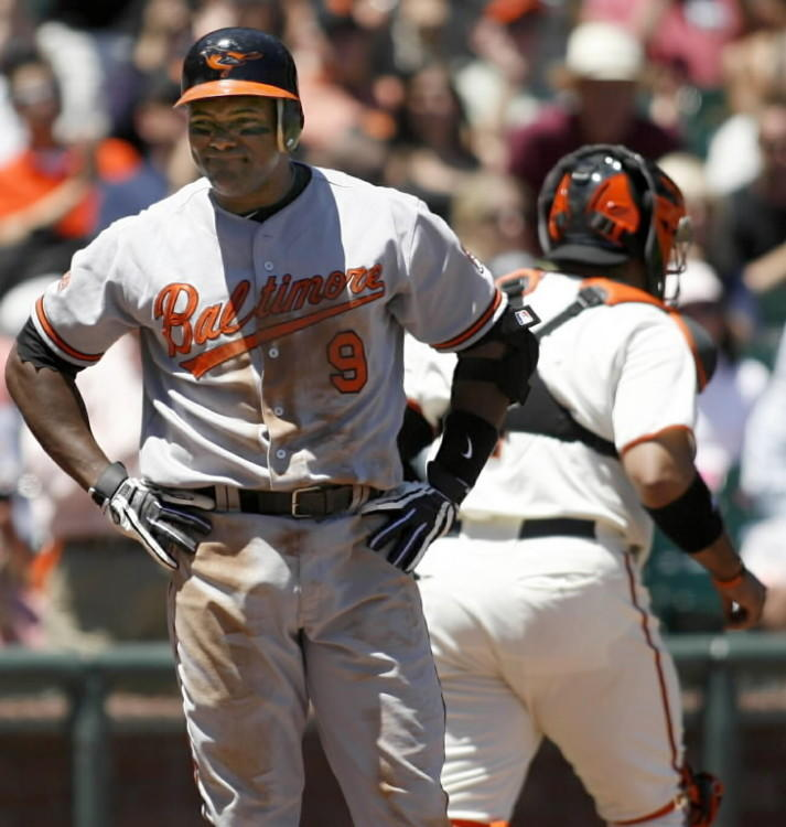 "<a class=""taxInlineTagLink"" id=""ORSPT000160"" title=""Baltimore Orioles"" href=""/topic/sports/baseball/baltimore-orioles-ORSPT000160.topic"">The Orioles</a>' <a class=""taxInlineTagLink"" id=""PESPT008494"" title=""Miguel Tejada"" href=""/topic/sports/baseball/miguel-tejada-PESPT008494.topic"">Miguel Tejada</a> reacts after striking out against Giants ace Tim Lincecum with two runners on in the fourth inning of host San Francisco's eventual 6-3 victory. Lincecum struck out 10 Orioles in six innings."