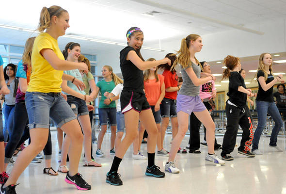 "Easton Area Middle School held its 3rd Thon to raise money for pediatric cancer research on Friday. These students participated in the Zumba class.  The students could also play dodgeball and basketball, play video games, listen to bands and tape a teacher to a wall. The only rule was ""No Sitting!"""