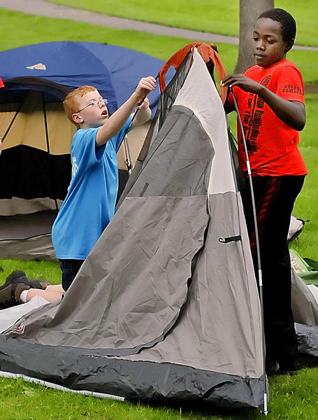 Hunter Clark, left, and Zahir Scott put up a tent near the Hager House on Friday afternoon. The two Boy Scouts from Troop 05 are joining others in the Founder's Day Camp-o-ree over the weekend.