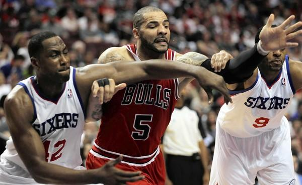 Chicago Bulls' Carlos Boozer battles Philadelphia 76ers' Elton Brand and Andre Iguodala in 2nd quarter during Game 3 of NBA Eastern Conference Quarterfinals at Wells Fargo Center in Philadelphia.
