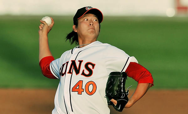 Chien-Ming Wang, a Washington Nationals pitcher making a rehab start with the Hagerstown Suns, delivers a pitch against the Rome Braves on Friday night at Municipal Stadium.