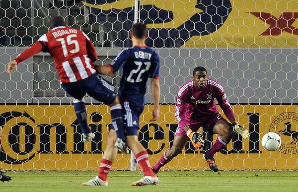 Fire goalkeeper Sean Johnson looks for the ball on a shot attempt by Chivas USA's Alejandro Moreno during the first half.