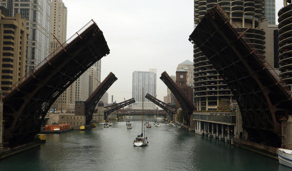 The bridges at State Street, Dearborn Street and Clark Street open for sail boats. A sure sign that winter is approaching, sail boats head for their storage inland on the Chicago River Wednesday, Oct. 12, 2005. Chicago Tribune photo by Jose More