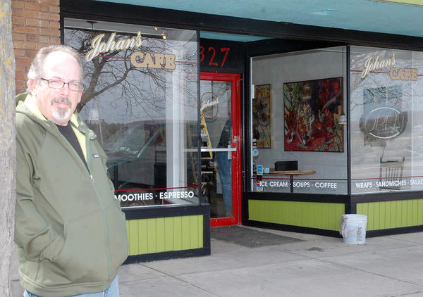 John Sheets, manager of Johann's Cafe in downtown Charlevoix stands outside the storefront Tuesday as last-minute preparations are being made for the store's opening.