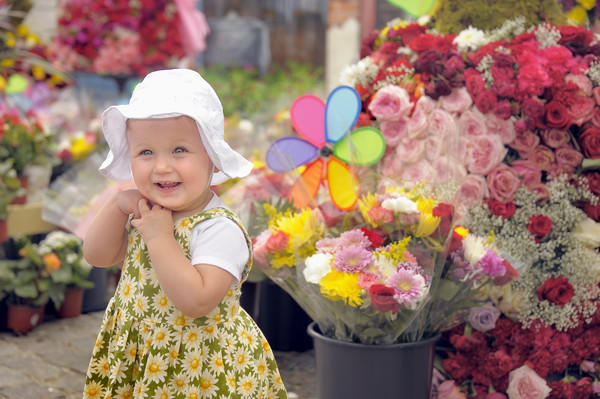 Sadie Gunderson, 14 months, enjoys the sights at the annual Flowermart in Mount Vernon. Her father, Jeremy Gunderson of Baltimore, brought her to share in the century-old rite of spring held at the base of the Washington Monument on North Charles Street.