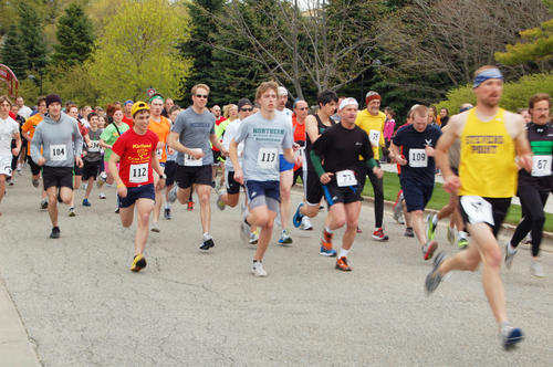 Runners begin the 5K race for mental health awareness at Petoskey's waterfront.