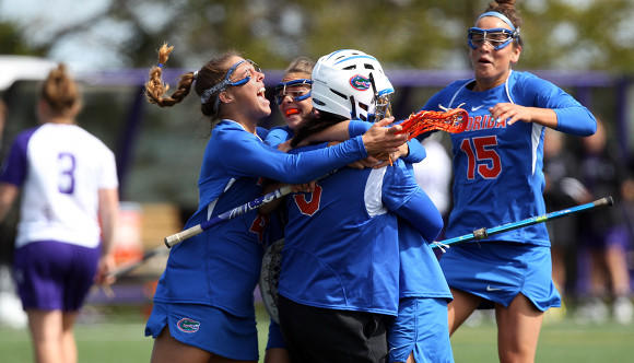 Same old story: Florida, shown celebrating its April 21 win at Northwestern, did it again Saturday.