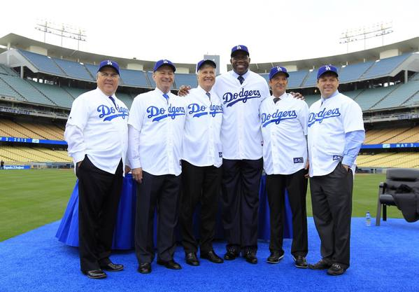 "New Dodgers owners (L-R) Robert L. Patton, Jr., Stan Kasten, Mark Walter, Earvin ""Magic"" Johnson, Peter Guber, and Todd Boehly pose."