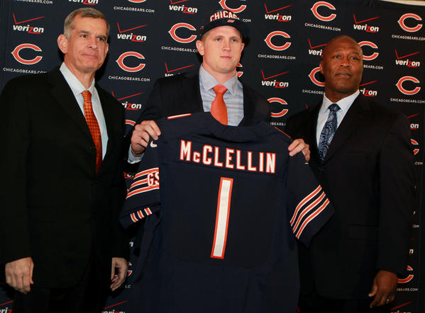 GM Phil Emery (left) and coach Lovie Smith (right) introduce 2012 1st round draft pick Shea McClellin.