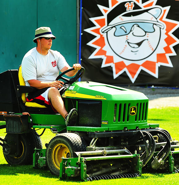 Hagerstown Suns Head Groundskeeper Brian Saddler trims outfield grass Friday morning at Municipal Stadium. He is in his first year of grooming the Suns field.