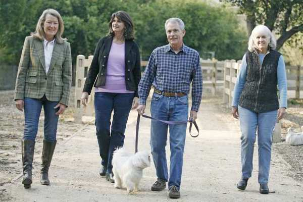 Council members Randy Strapazon, from left, Debbie Tinkham, President Ted Stork and Mary Barry walk on the Trails Council Link in La Canada.