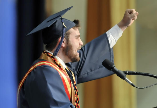 Michael Bailey of Shepherdstown pumps up the graduates as he gives his welcome speech at commencement exercises for Shepherd University.