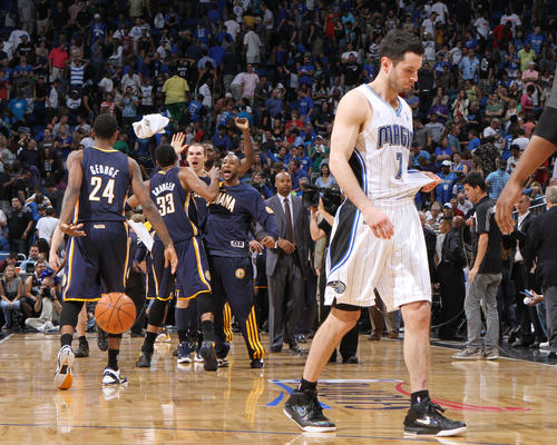 Orlando guard J.J. Redick (7) walks off the court as Indiana celebrates following the Magic's 101-99 overtime loss to the Pacers in game four of their NBA Eastern Conference playoff series in Orlando, Fla. Wednesday, May 5, 2012.