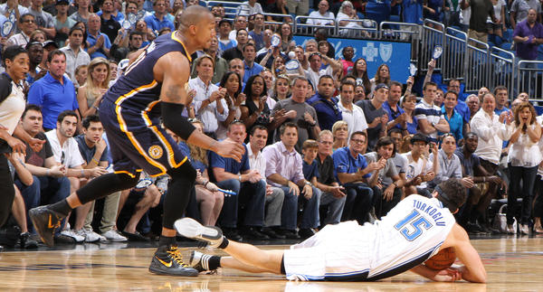 Orlando forward Hedo Turkoglu (15) dives to the floor calling a timeout to save the possession while battling with Indiana forward David West (21)during the Magic's 101-99 overtime loss to the Pacers in game four of their NBA Eastern Conference playoffs series in Orlando, Fla. Saturday, May 5, 2012.