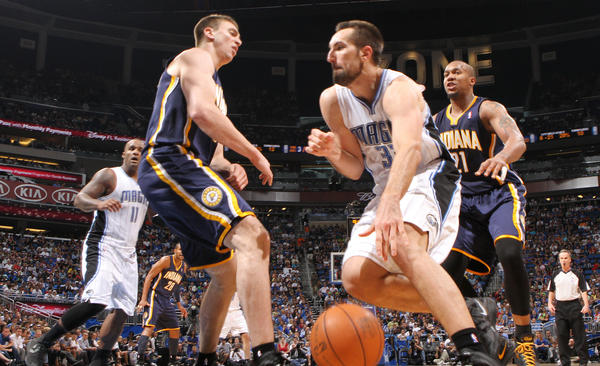 Orlando forward Ryan Anderson (33) runs into Indiana forward Tyler Hansbrough, committing the charge during the Magic's 101-99 overtime loss to the Pacers in game four of their NBA Eastern Conference playoffs series in Orlando, Fla. Saturday, May 5, 2012.