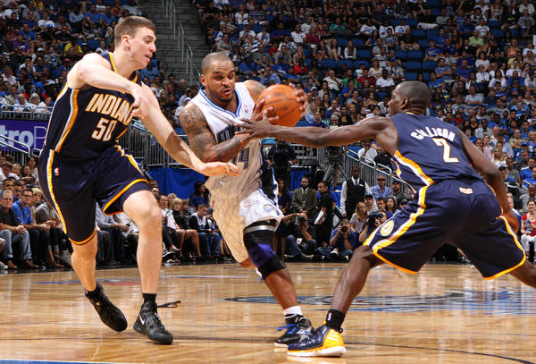 Orlando's Jameer Nelson (14) drives in between Indiana's Tyler Hansbrough (50) and Darren Collison (2) during the Magic's 101-99 overtime loss to the Pacers in game four of their NBA Eastern Conference playoffs series in Orlando, Fla. Saturday, May 5, 2012.